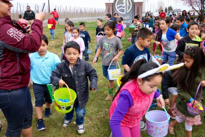 Easter Egg Hunt kids looking for eggs
