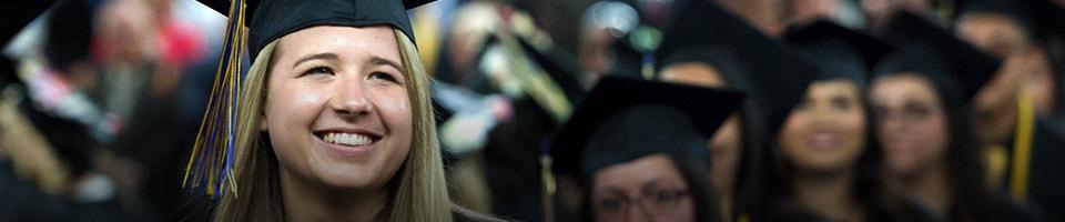Student happy cheering during graduation ceremony at heritage university