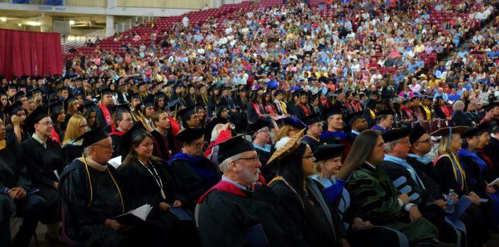 Group of heritage alumni sitting during graduation ceremony