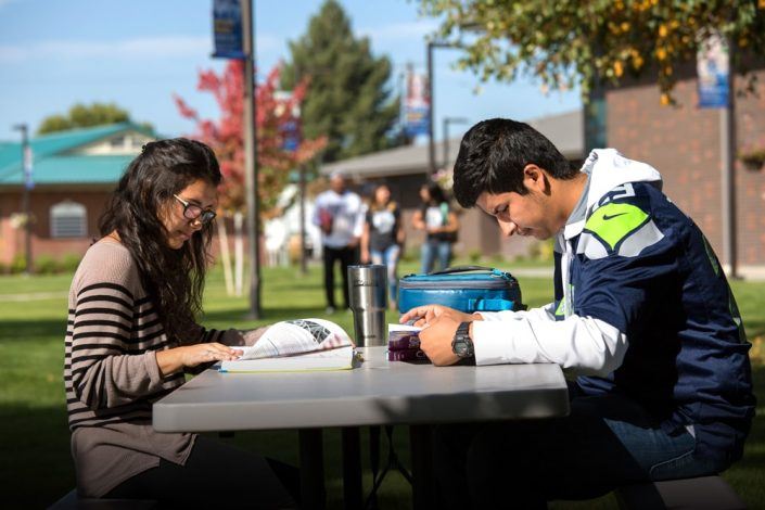 Students reading outside on Heritage campus